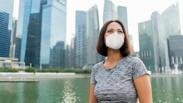 Businesswoman in Singapore wearing a face mask.