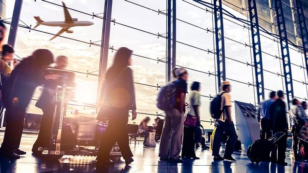 People walking through airport (Photo via 06photo / iStock / Getty Images Plus)