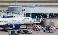 A Delta Air Lines aircraft sits parked at Orlando International Airport