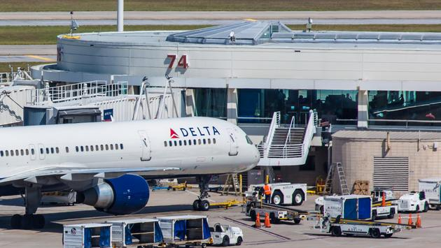 A Delta Air Lines aircraft sits parked at Orlando International Airport