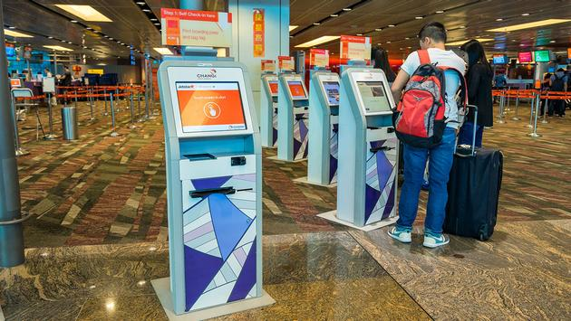 Self check-in kiosks (Photo via CharlieTong / iStock Editorial / Getty Images Plus)