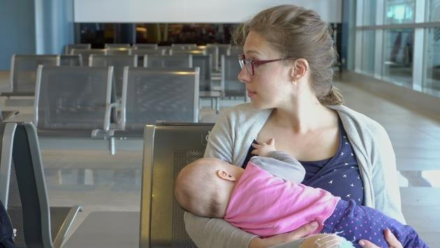 Woman Breastfeeding her Child at the Airport