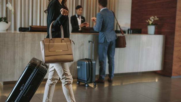 Female guest walks inside a hotel lobby