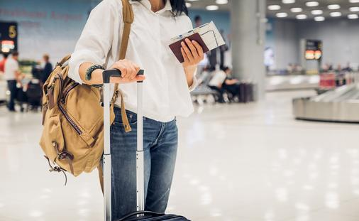 woman with luggage at airport