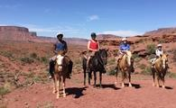Horseback riding in Moab. From left, the author's partner, Lance; the author; their sons Joshua and Matthew
