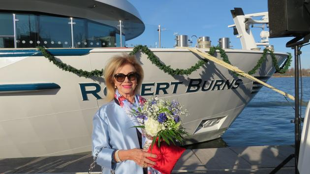 Omega World Travel founder Gloria Bohan on April 3 officially named Riviera River Cruises' 167-passenger MS Robert Burns