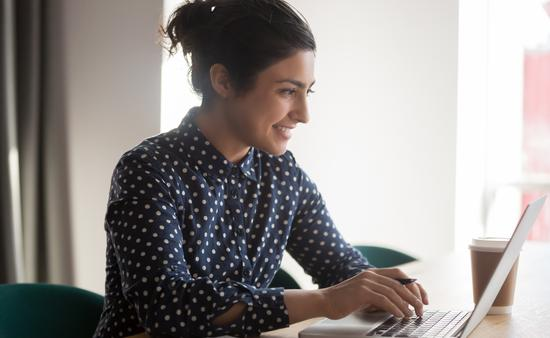 Woman working from her laptop