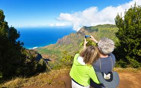 Tourist couple at Waimea Canyon State Park, Kauai, Hawaii
