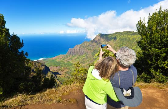 Tourist couple at Waimea Canyon State Park, Kauai, Hawaii