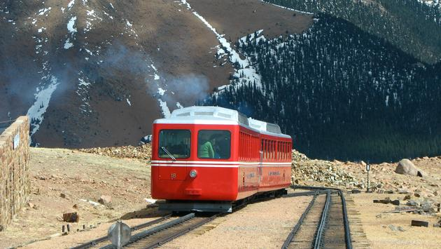 Colorado's historic Broadmoor Manitou and Pikes Peak Cog Railway climbing its Rocky Mountain track.