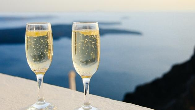 Champagne glass, luxury travel, affluent travel