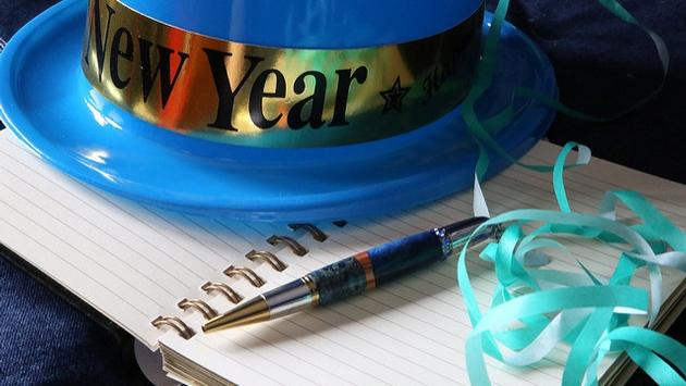 New Year's hat, notebook and pen