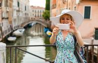 Tourist taking photos in Venice, Italy.