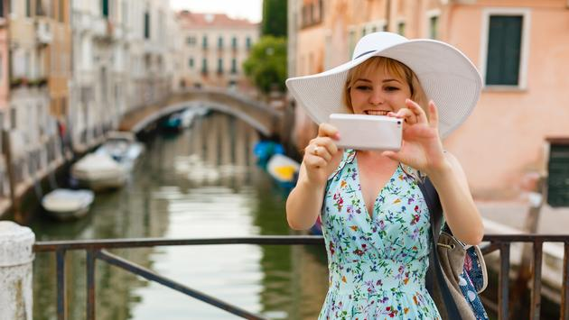 Tourist taking photos in Venice, Italy.