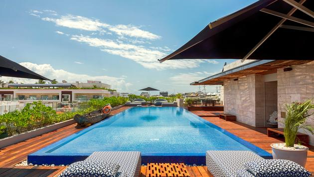 Rooftop pool at The Yucatan Resort Playa del Carmen, Tapestry Collection by Hilton