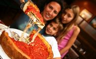 Family enjoying deep-dish Chicago-style pizza