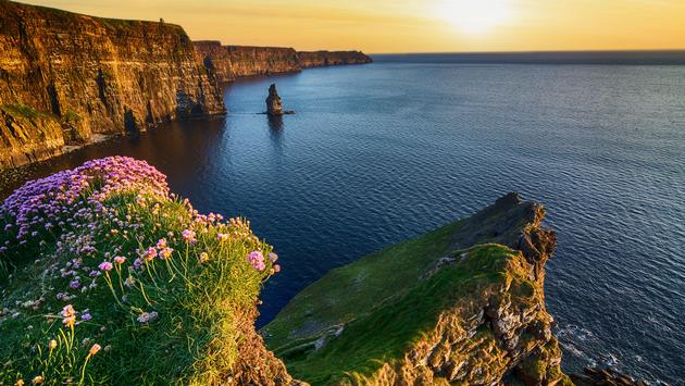 sunset at the cliffs of moher in county clare, ireland