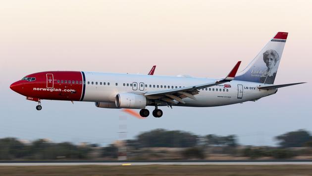 Panned shot of a Norwegian Jetliner