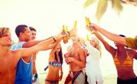 A group of friends celebrating on a tropical beach