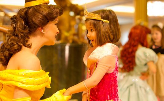 "Belle from the classic Disney film ""Beauty and the Beast"" meets a young guest aboard the Disney Fantasy."
