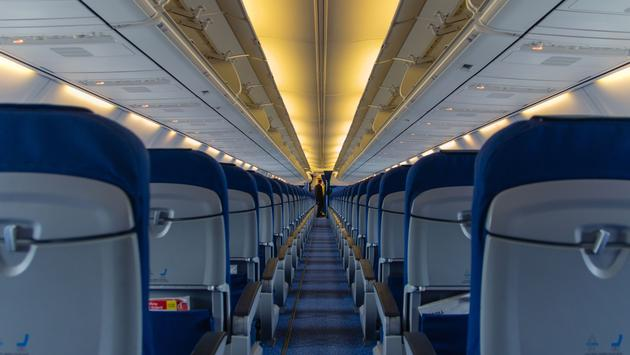 Blue seats in empty airplane