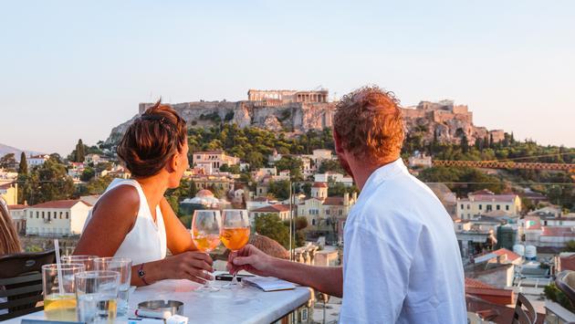 Travelers enjoying a drink in Greece.