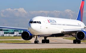 Delta Boeing 767-332ER taxiing towards the airport runway
