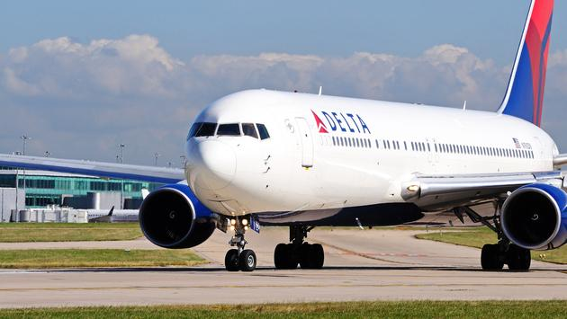 Delta Boeing 767-332ER taxiing towards the airport runway