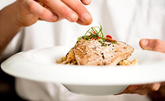 Chef preparing a tuna appetizer