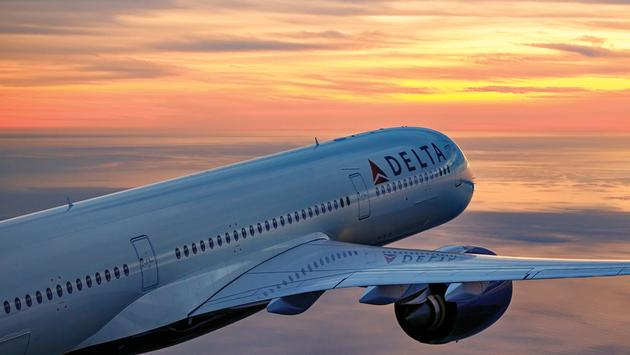 Delta Air Lines plane at sunset.
