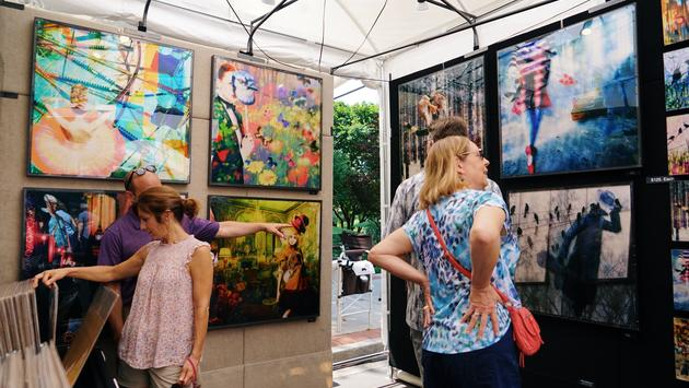 Visitors browse vendor booth at Artisphere in Greenville, South Carolina.