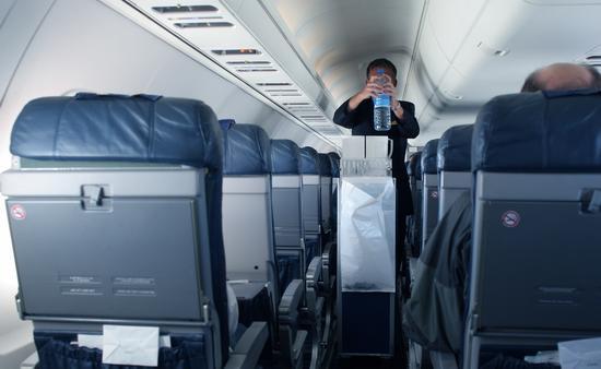 Flight attendant with beverage cart