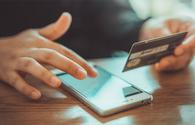 Mobile Pnone Shopping Online With A Debit Card (Photo via ArisSu / iStock / Getty Images Plus)