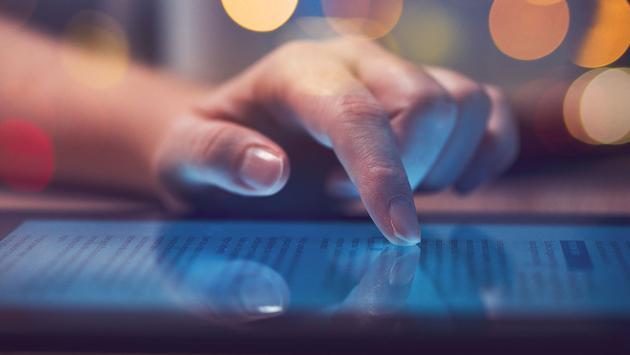 Woman reading online on digital tablet (Photo via stevanovicigor / iStock / Getty Images Plus)