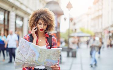 Woman lost in the city (Photo via Astarot / iStock / Getty Images Plus)
