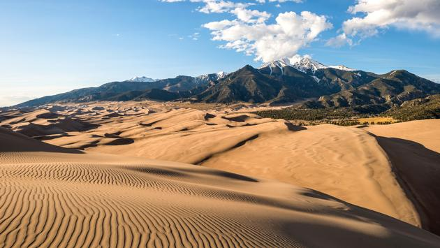 Sunset view of sand waves at the top of Great Sand Dunes National Park & Preserve, Colorado