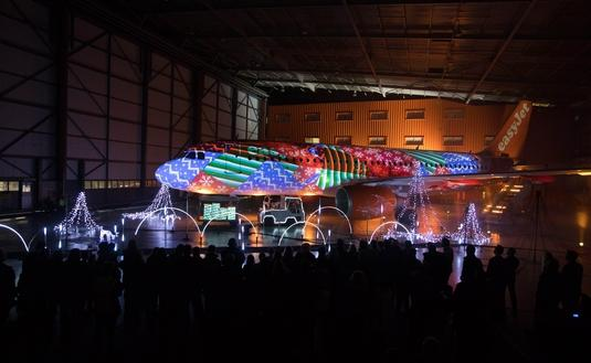 A holiday light show on an easyJet aircraft at Luton Airport
