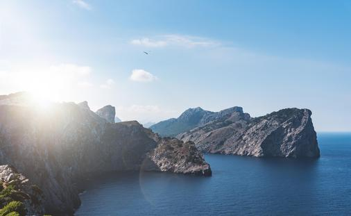 Scenic Mediterranean sea and coastline with steep cliffs on island of Majorca at sunset