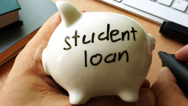 Student loan written on a piggy bank. (Photo via designer491 / iStock / Getty Images Plus)