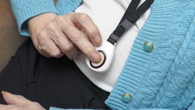 Woman pressing a panic button