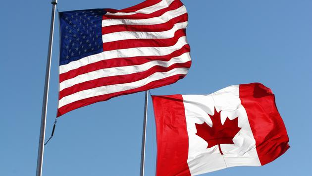 The U.S. and Canadian national flags.