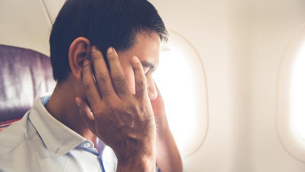 Man annoyed on airplane