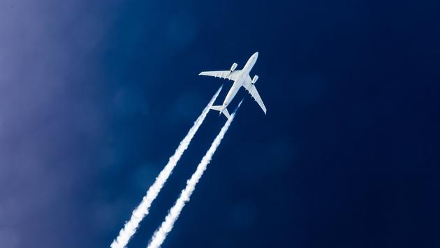 The vapor trails of an Airbus 330 operated by Etihad Airways.