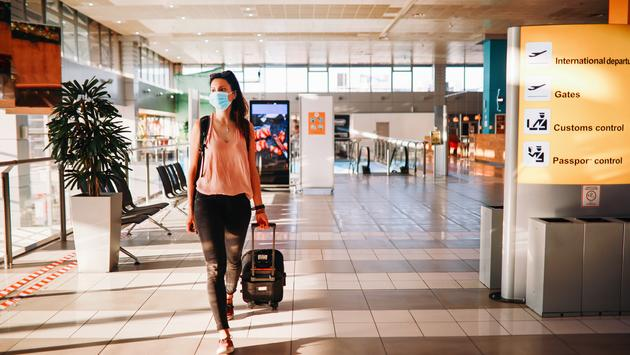 Woman taking a stroll through the airport during the COVID-19 pandemic.