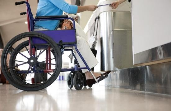 Woman in wheelchair at airport