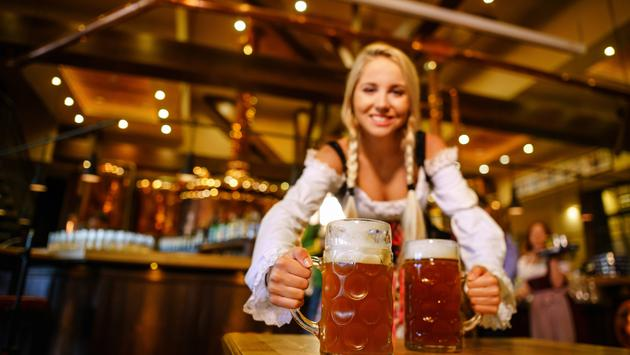 Waitress serving beers at Oktoberfest