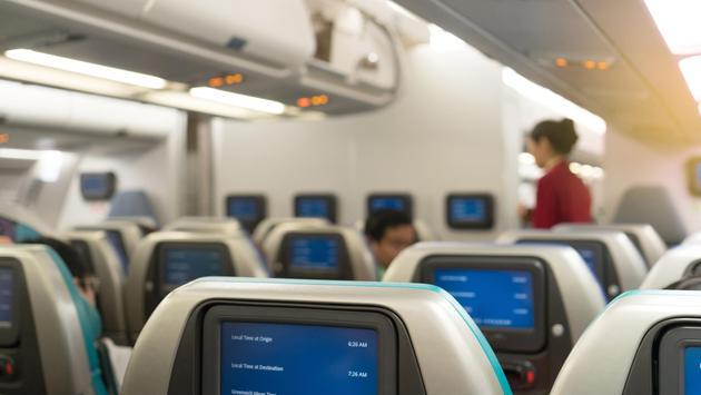 Flight attendant helping passenger