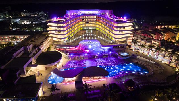 Aerial view of Temptation Cancun Resort at night.