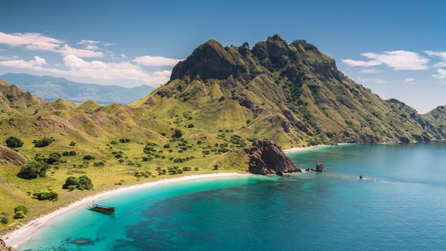 Aerial view of a beautiful bay with a white sand beach in the famous Komodo National Park in Flores island of Indonesia