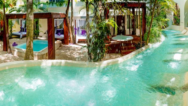 Sensoria Chill Out & Spa's outdoor garden area at Grand Oasis Palm, Cancun, Mexico.